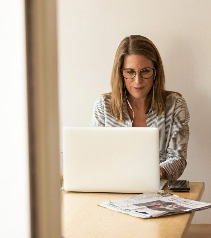woman-sitting-while-using-laptop-1251828